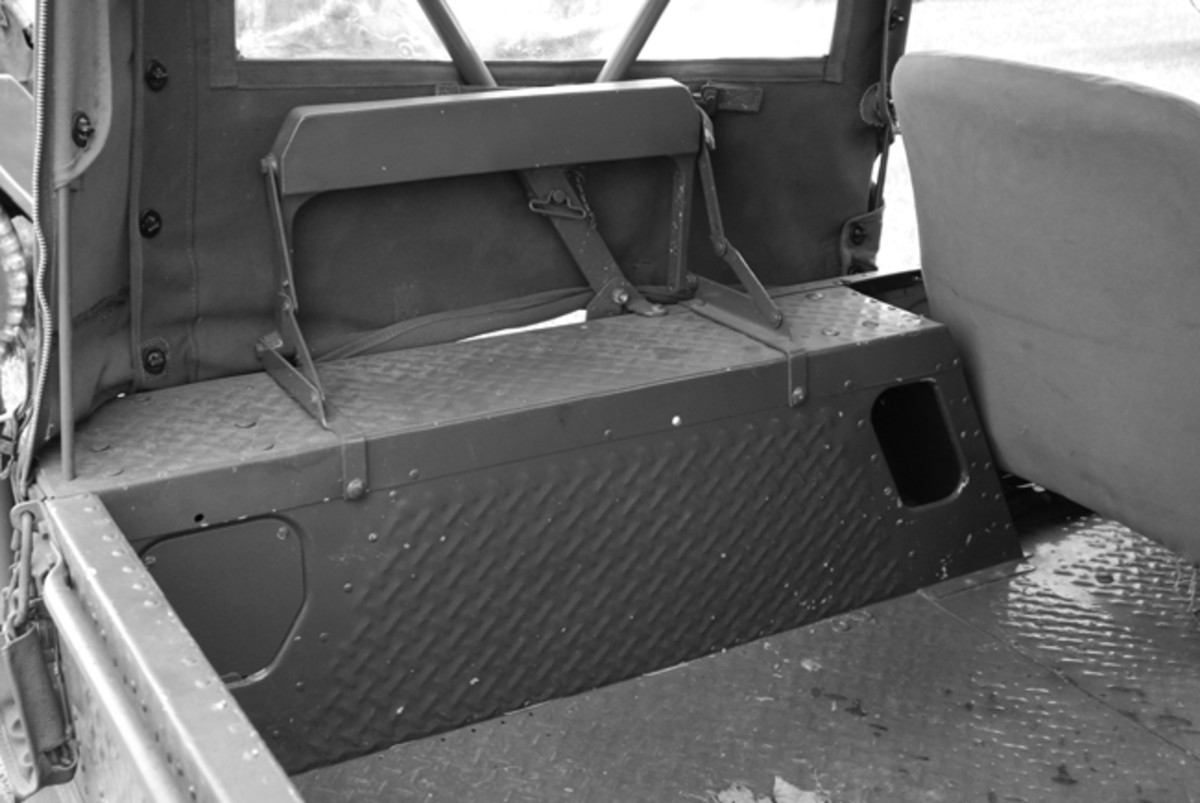 The M422 had rear seats in the tailgate that folded down. The M422A1 had them on the rear fender tops as seen here. John Adams-Graf photo