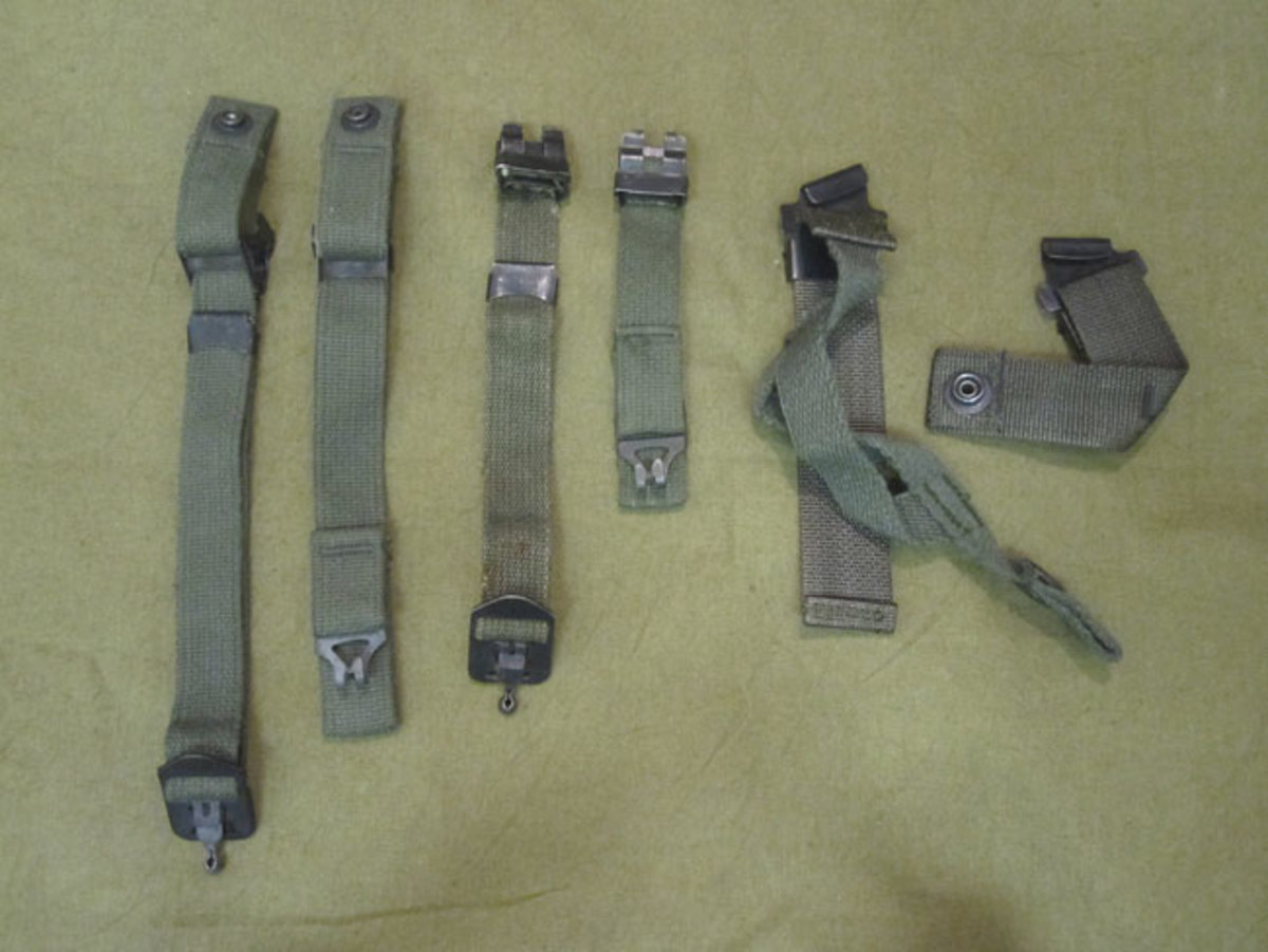 The following chin straps are common upgrades that can be found on post-war-modified WWII manufactured helmets. From left to right: A pair of clamped chin straps with male snaps for the parachutist M1 helmet and liner next to a pair of standard infantry chinstrap used from early 1950s to the mid-1970s. The buckle and loop clamps of the initial issue of this chinstrap were painted green. The last issue chin strap was introduced in FM 21-15 by 1972 . It clipped on to the helmet loops and incorporated a chin cup previously reserved for the parachutist helmet.