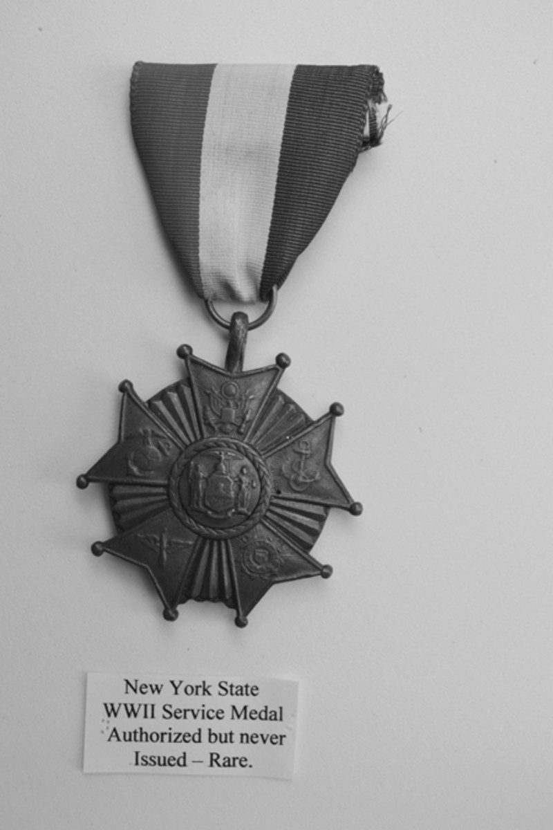 The New York WWII prototype was made after initial authorization with only a few getting into circulation. The Honeybrook, Penn., is also rare, but the Utica, New York, medal is easily found. - New York State Prototype