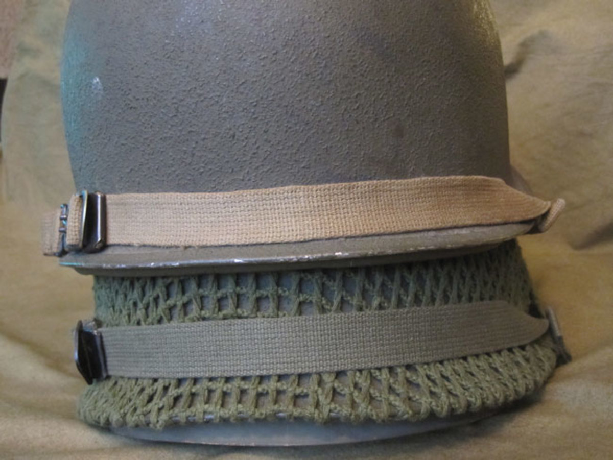 From 1941 to late 1943, chin straps were constructed of cotton webbing in olive drab shade number three.