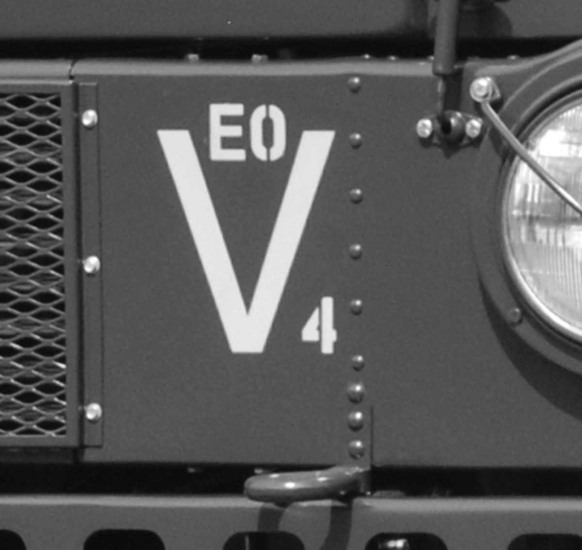 "During the restoration, Paul uncovered this set of markings on the front of the truck. He hasn't been able to to confirm its meaning. Does anyone know what the ""EO"" inside a ""V/4"" indicates?"