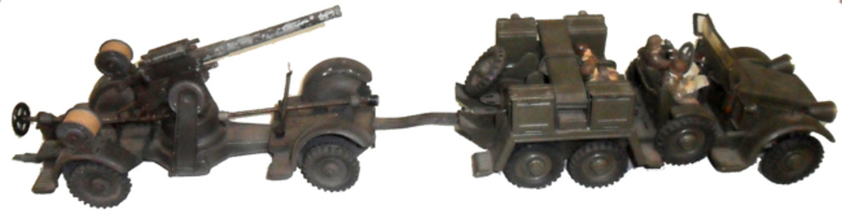 """The Krupp """"Protze"""" was rendered in accurate miniature by Hausser and is shown here complete with an Elastolin Wehrmacht army troops."""