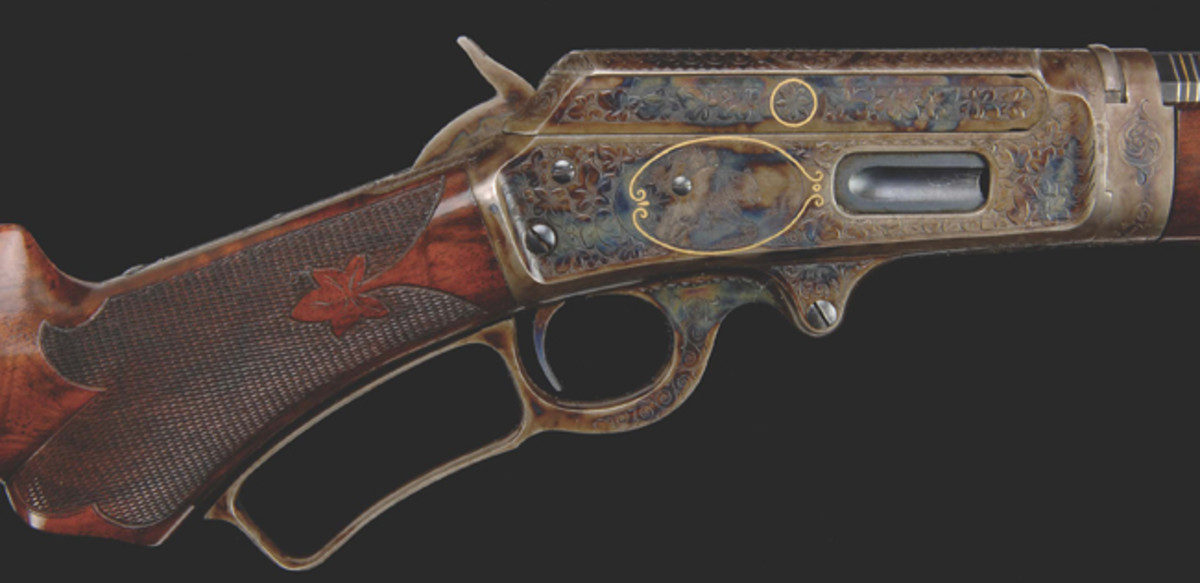 "From a private Southern collection of Winchesters is an iconic Nimchke ""Bank Note"" engraved Winchester M66 with the image of Columbia."