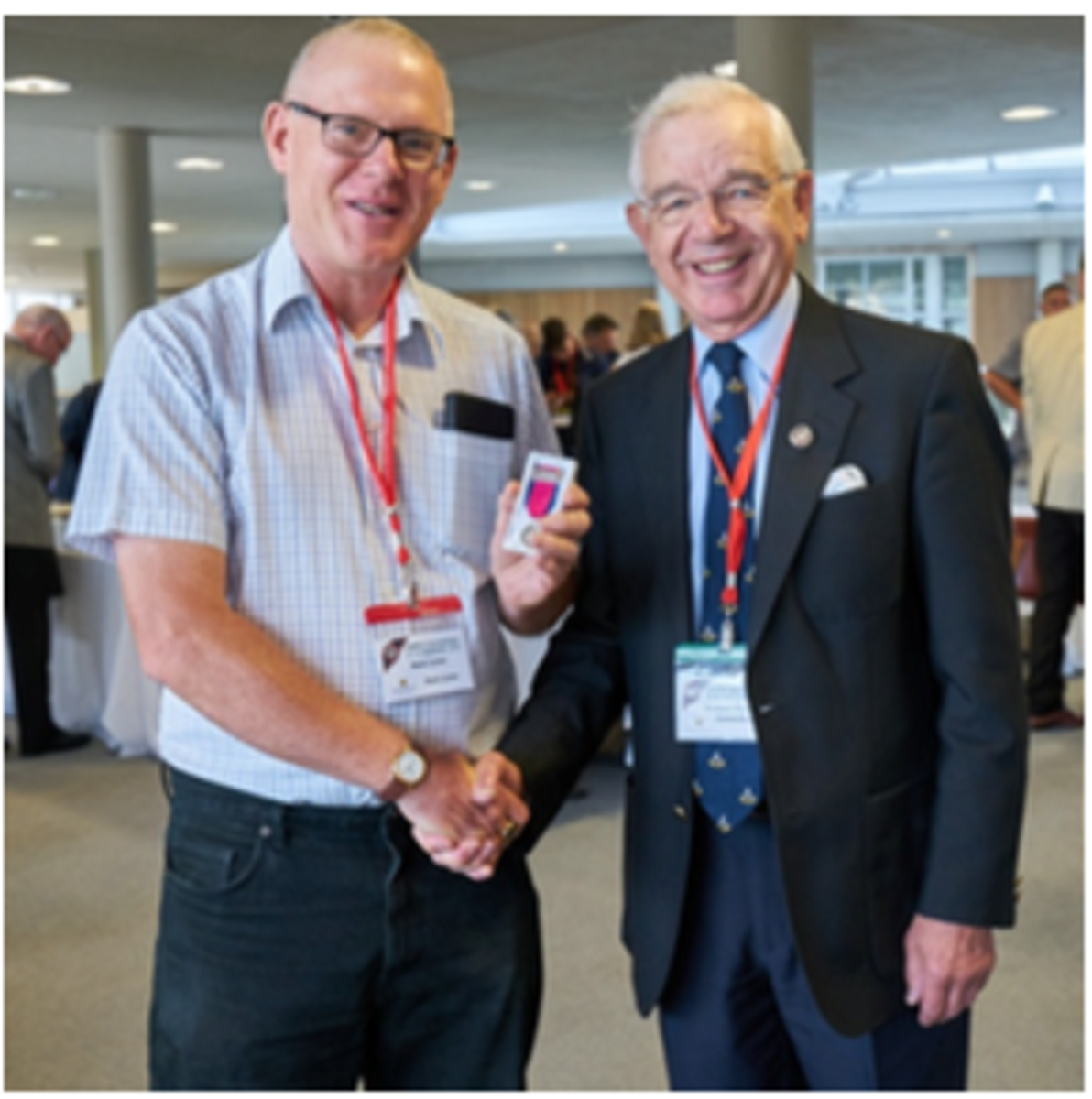 Fair organizer Mark Carter receives his OMRS medal from Society President Air Commodore Graham Pitchfork