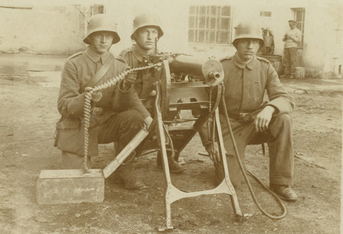 A three-man crew at the ready of their MG 08. Members of the MG-Scharfschuetzen (machine gun sharpshooters) who mastered their training were awarded a proficiency badge, first authorized in January, 1916.