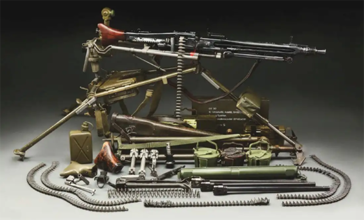 Gustloff (Germany) WWII MG-42 machine gun on MG3 mount with Nazi proofs. Comes with numerous accessories.
