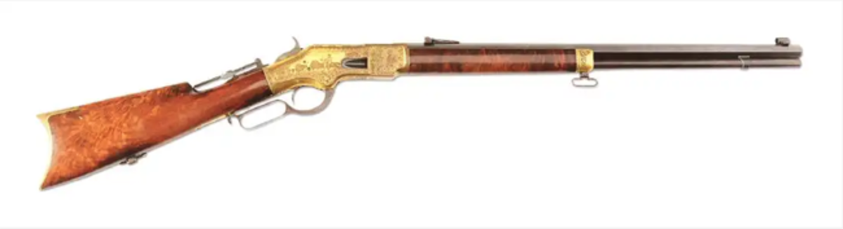 Extremely rare Winchester Model 1866 gilded rifle, .44 caliber, lavish factory engraving that depicts an Indian on horseback hunting buffalo.