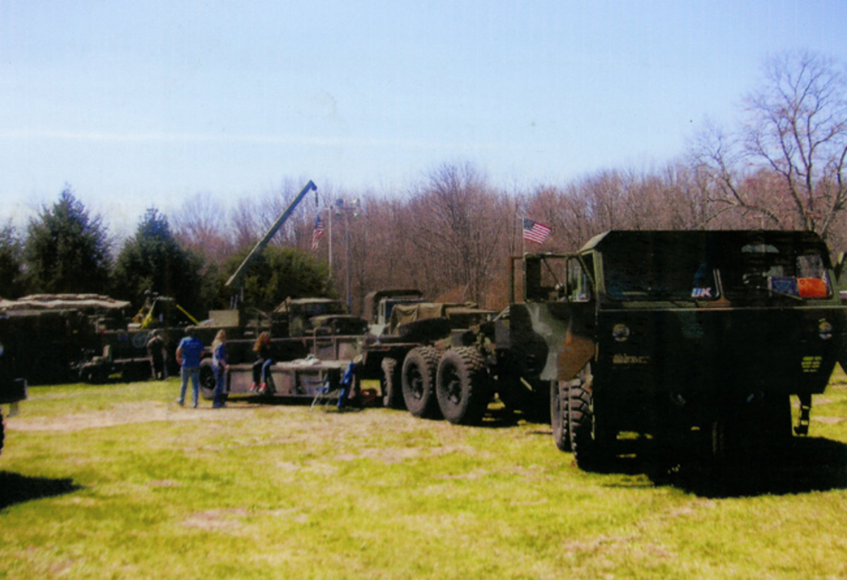 GI trucks large enough to haul armor brought tanks to the show.