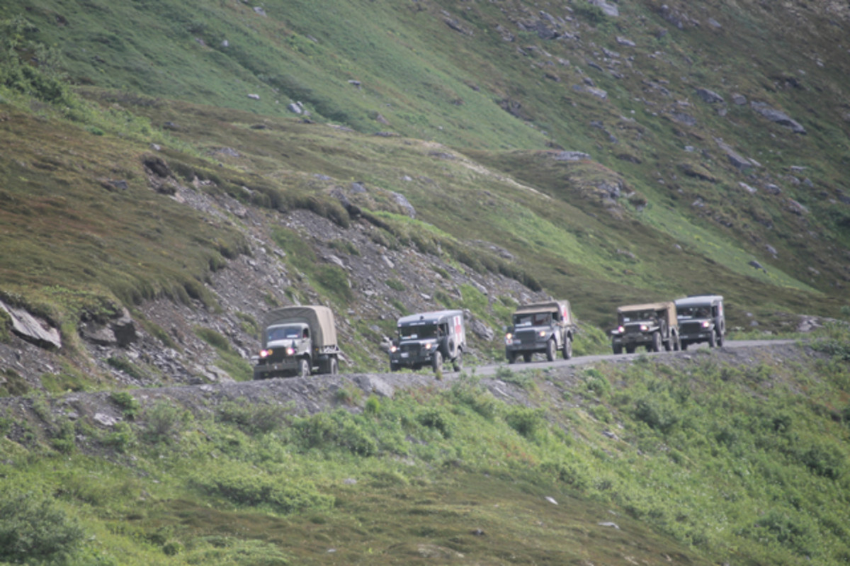 Dodge trucks descending the steep and rough grade after crossing the famous Hatcher Pass.