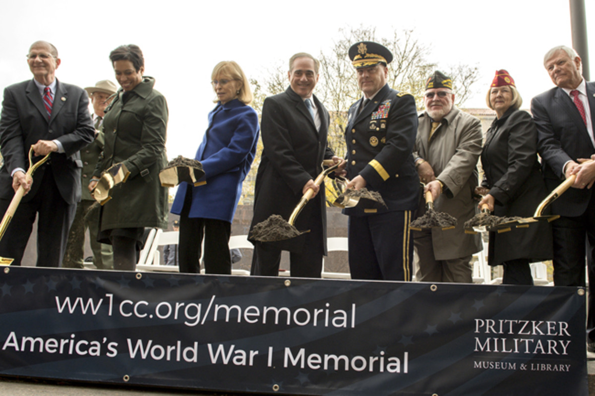 The official groundbreaking party, including Chief of Staff of the Army Gen. Mark Milley, fourth from the right, breaks ground for the the National World War I Memorial at Pershing Park in Washington, D.C., Nov. 9, 2017. Construction of the memorial is expected to be completed in a year. (Photo Credit: U.S. Army photo by EJ Hersom)