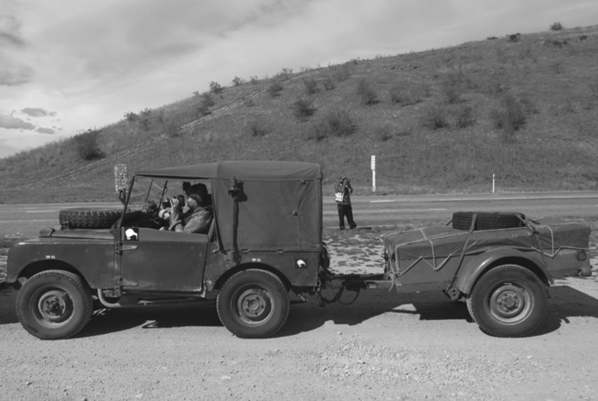 "Brent Bevan and his 1951 80"" Land Rover at a morning pit stop."
