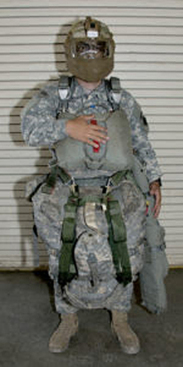 Soldier configured with the new Integrated Head Protection System (IHPS) with the mandible, while wearing combat equipment. (Photo by Rebecka Waller, Audio Visual Production Specialist, Airborne and Special Operations Test Directorate, U.S. Army Operational Test Command)
