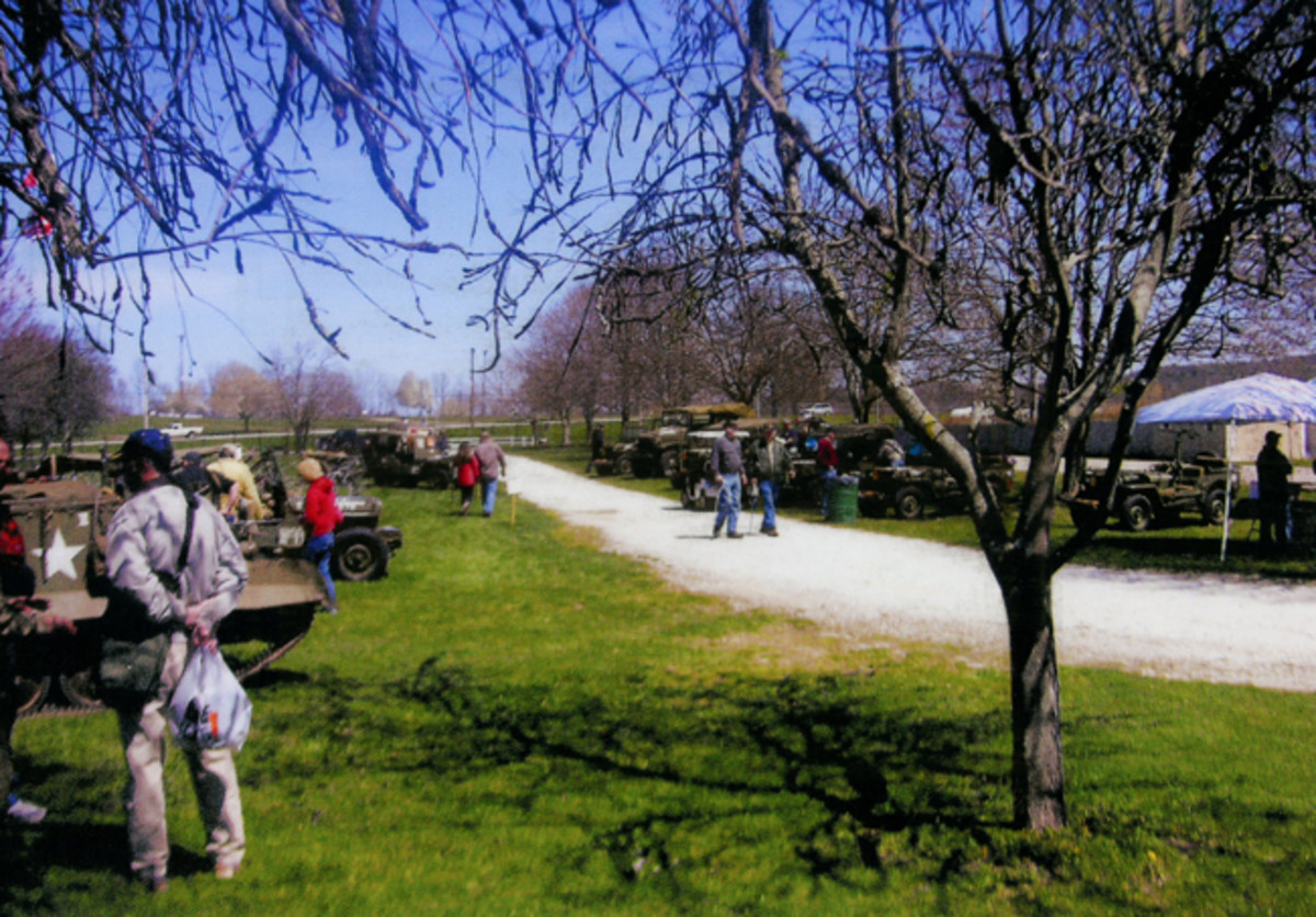 WWII area of vehicles and reenactors.