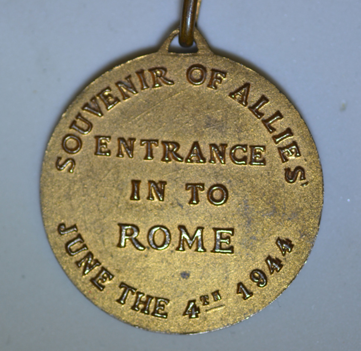 The reverse inscription used by the Type 2 and 3 Rome Liberation Medals indicates the date when the 5th Army and General Mark Clark entered the Open city of Rome.