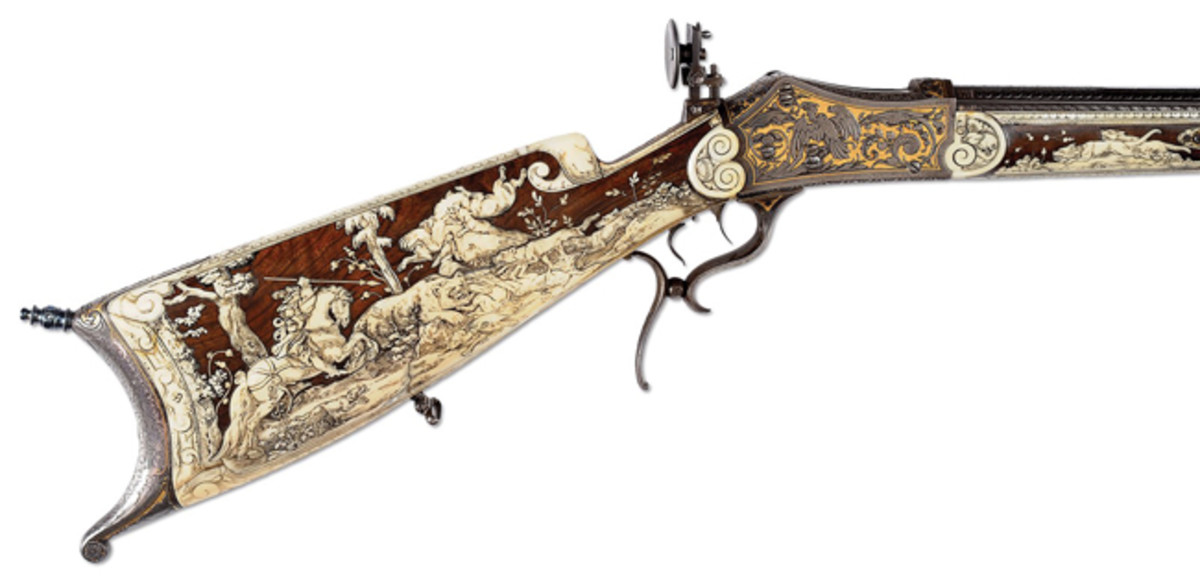 The ultimate Schuetzen rifle. An extraordinary high art, ivory inlaid masterpiece with deep chiseled engraving and gold embellishments. It had been made for a special shooting prize in the late 1880s and came from the remarkable Allen Hallock Collection. This is Session One of Hallock's magnificent collection of Schuetzen rifles. This came to the block with a presale estimate of $30,000-40,000 and generated $37,375.