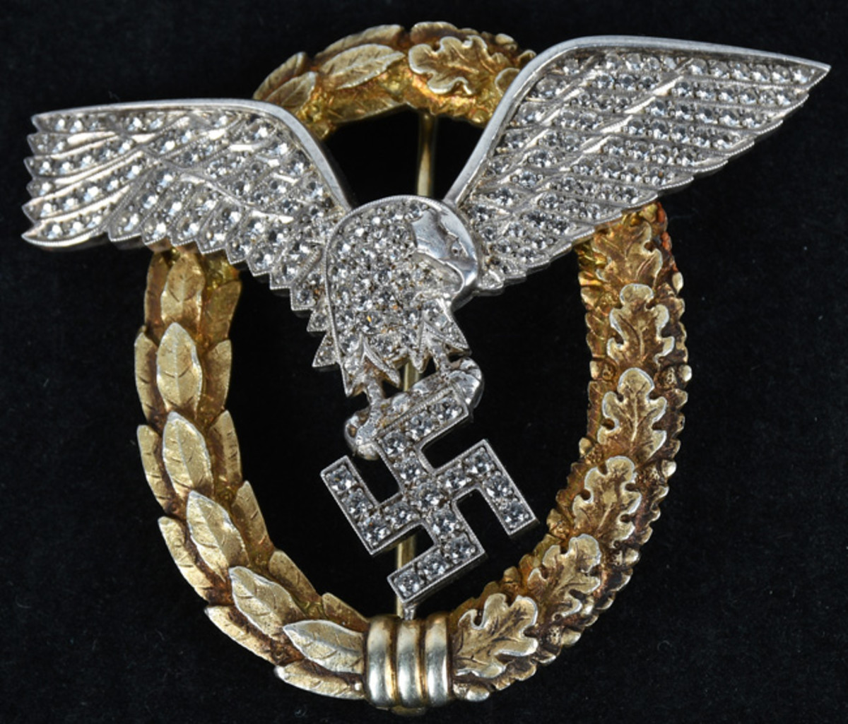 """WWII Nazi Luftwaffe gold """"Double Badge,"""" 150 brilliant-cut diamonds, created under instruction of Hermann Goring, who awarded them to favored Luftwaffe pilots, other important Third Reich figures. Detlev Niemann COA. Estimate: $70,000-$80,000. Milestone Auctions"""