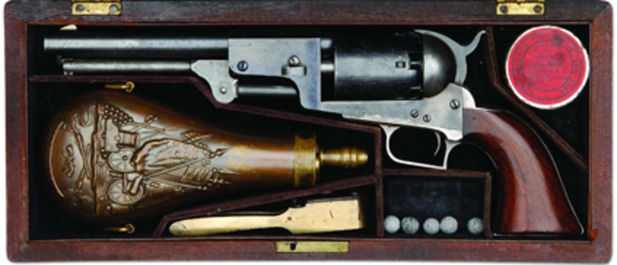 Cased 2nd Model Colt Dragoon percussion revolver in outstanding condition sold for LD $86,250.