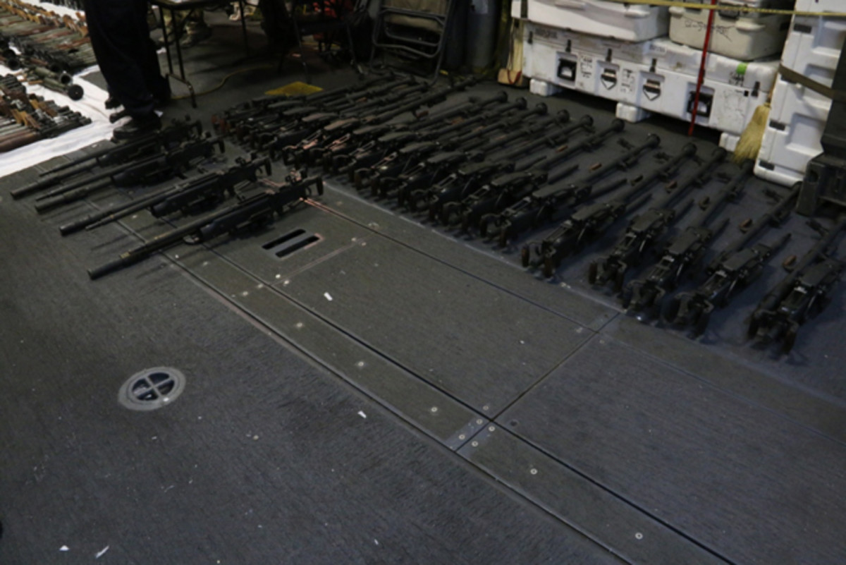 160331-N-KL526-366 ARABIAN SEA (March 31, 2016) A cache of weapons is assembled on the deck of the guided-missile destroyer USS Gravely (DDG 107). The weapons were seized from a stateless dhow which was intercepted by the Coastal Patrol ship USS Sirocco (PC 6) on March 28. The illicit cargo included 1,500 AK-47s, 200 RPG launchers, and 21 .50 caliber machine guns. Gravely supported the seizure following the discovery of the weapons by Siroccoís boarding team. This seizure was the third time in recent weeks international naval forces operating in the waters of the Arabian Sea seized a shipment of illicit arms which the United States assessed originated in Iran and was likely bound for Houthi insurgents in Yemen. The weapons are now in U.S. custody awaiting final disposition. (U.S. Navy Photo/Released)