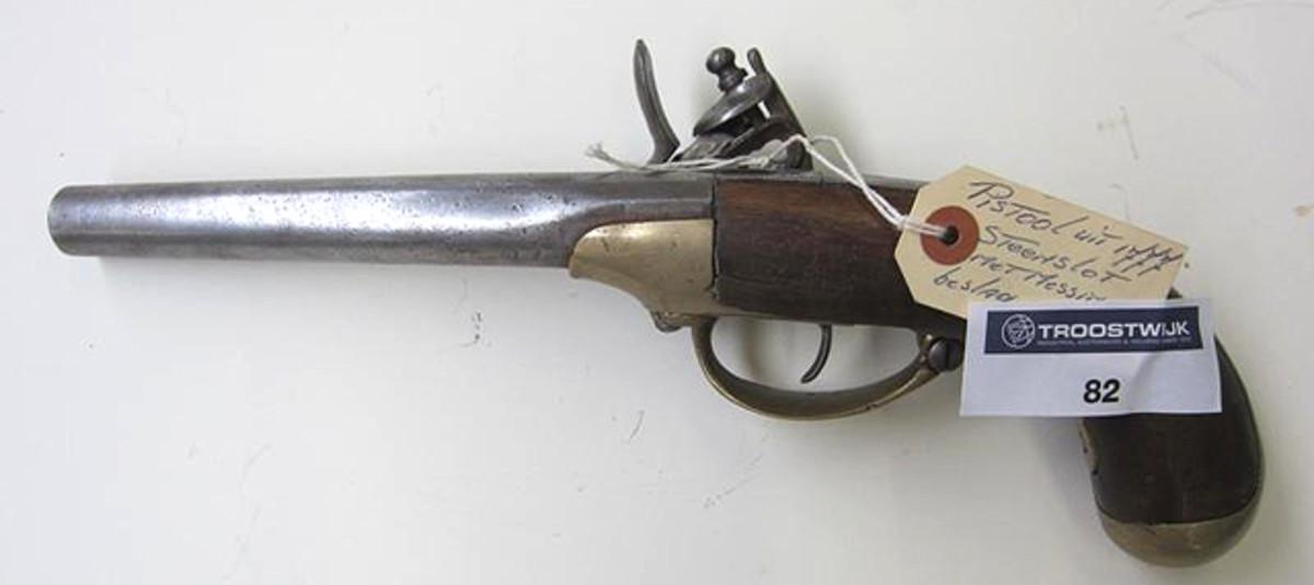 Lot 82. 1777 Flint lock pistol, with brass fittings.