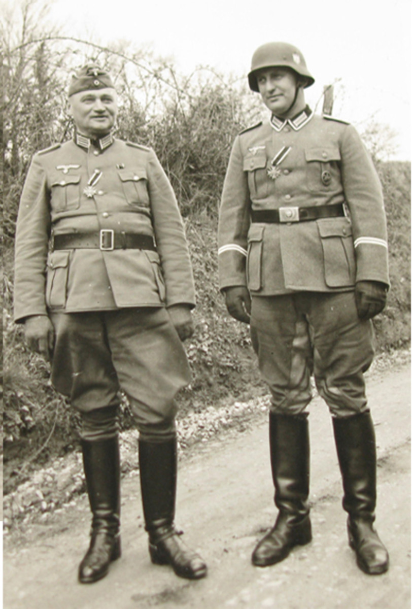 Hitler created a new award on October 18,1939, that recognized thousands of soldiers and civilians for their non-combative war efforts. Newly awarded Kriegsverdienstkreuz (War Merit Cross) medals hang from the buttonholes of an army officer and NCO (the NCO is also wearing a horseman's badge).