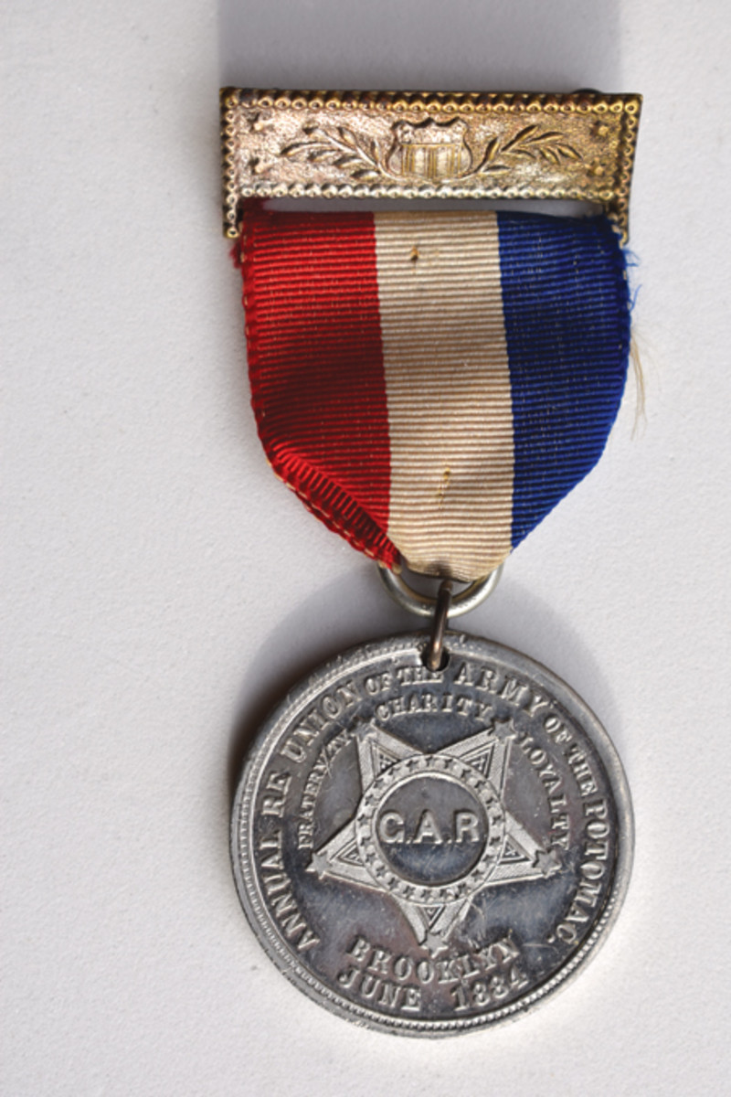 Coe's grouping includes a commemorative medal issued to guests of the 15 Annual Reunion by the City of Brooklyn.