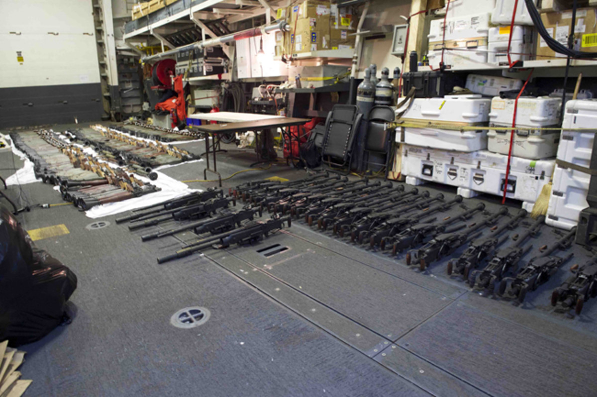 160331-N-JE250-365 ARABIAN SEA (March 31, 2016) A cache of weapons is assembled on the deck of the guided-missile destroyer USS Gravely (DDG 107). The weapons were seized from a stateless dhow which was intercepted by the Coastal Patrol ship USS Sirocco (PC 6) on March 28. The illicit cargo included 1,500 AK-47s, 200 RPG launchers, and 21 .50 caliber machine guns. Gravely supported the seizure following the discovery of the weapons by Sirocco's boarding team. This seizure was the third time in recent weeks international naval forces operating in the waters of the Arabian Sea seized a shipment of illicit arms which the United States assessed originated in Iran and was likely bound for Houthi insurgents in Yemen. The weapons are now in U.S. custody awaiting final disposition. (U.S. Navy Photo by Mass Communication Specialist 2nd Class Darby C. Dillon/Released)