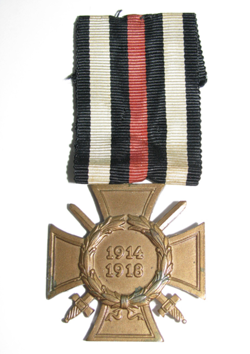 The bronze combatant's cross hung from a bright red, black and white ribbon