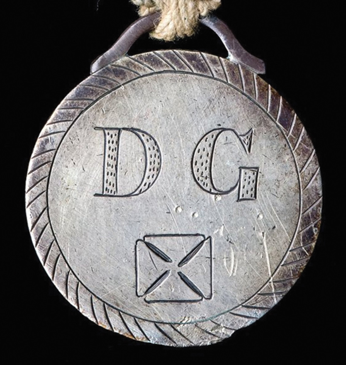 "The Davis Guard medal was a locally produced and issued Confederate medal of the Civil War. It was fashioned from a Mexican silver peso, each side smoothed off and engraved. The reverse is inscribed in three lines, ""Sabine Pass / Sept 8th / 1863."""