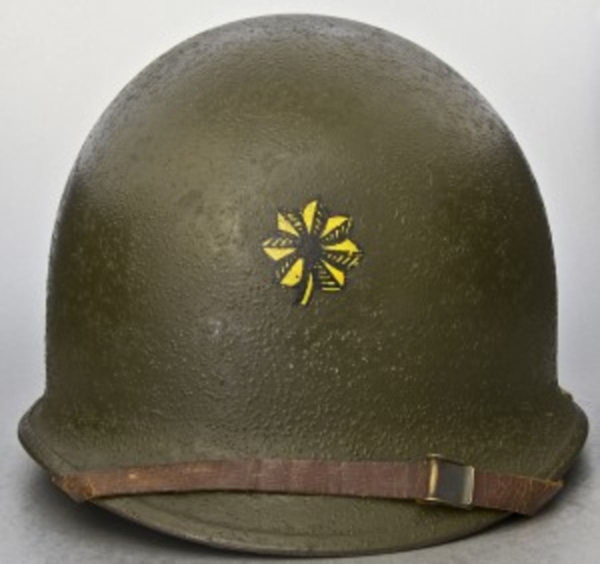 Major Winters wore this helmet after being recalled to service for the Korean War, serving as a regimental training officer of the 364th Infantry Regiment stationed at Fort Dix, New Jersey, from 1951-1952. The helmet is a late-WWII type with hinged chinstrap loops and a latter production heat lot number of 1189C (from around early 1945).
