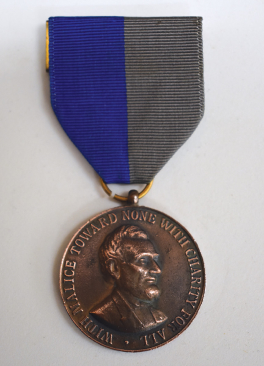 The Civil War Campaign Medal was not authorized until 1907. It used a grey and blue ribbon representing both the Union and Confederacy. Variations in design were used to represent service in the Army, Navy, or Marine Corps.