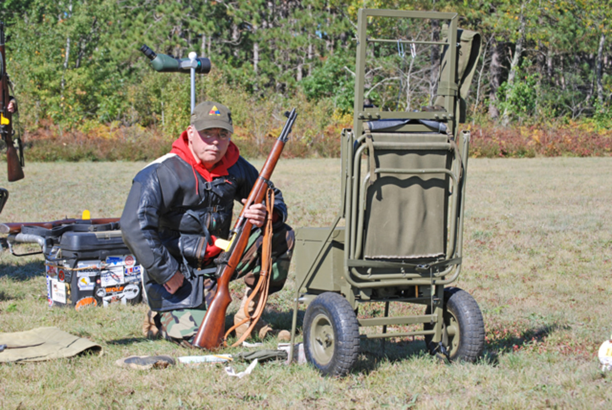 Collector, MVPA member and avid shooter, Jeff Rowsam posing with his custom-made shooting cart and M1 rifle.