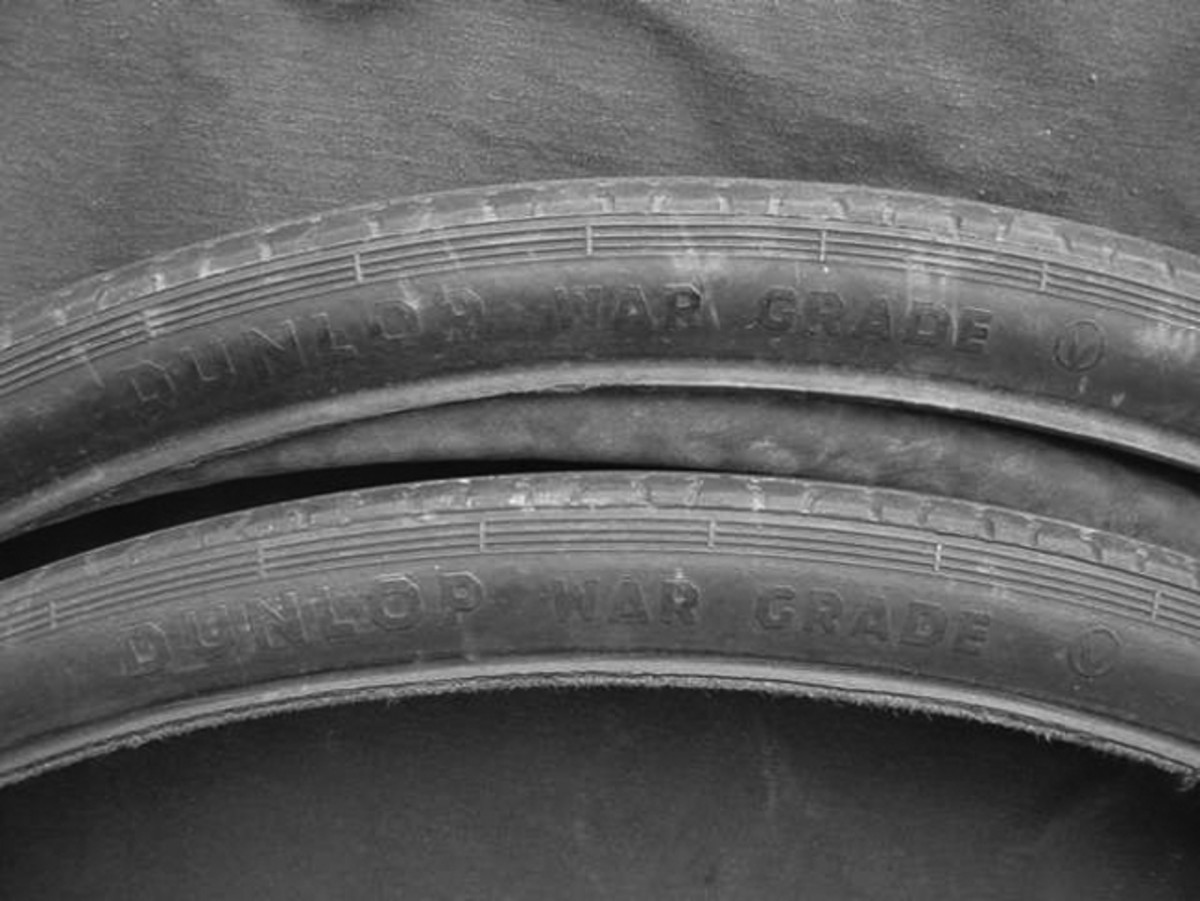 """The tires are original Dunlop brand and marked """"War Grade"""" followed by a circular logo with the classic V for Victory in the center."""