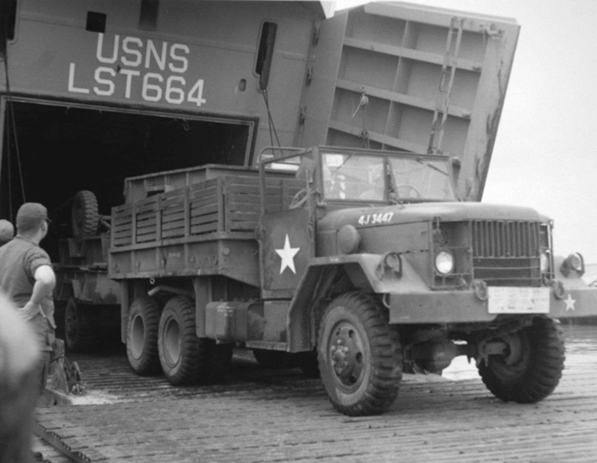 The early production multifuel cargo trucks bore registration numbers of the style used on this 1967 Kaiser-Jeep M35A2 exiting LST664 at Saigon in July 1968.