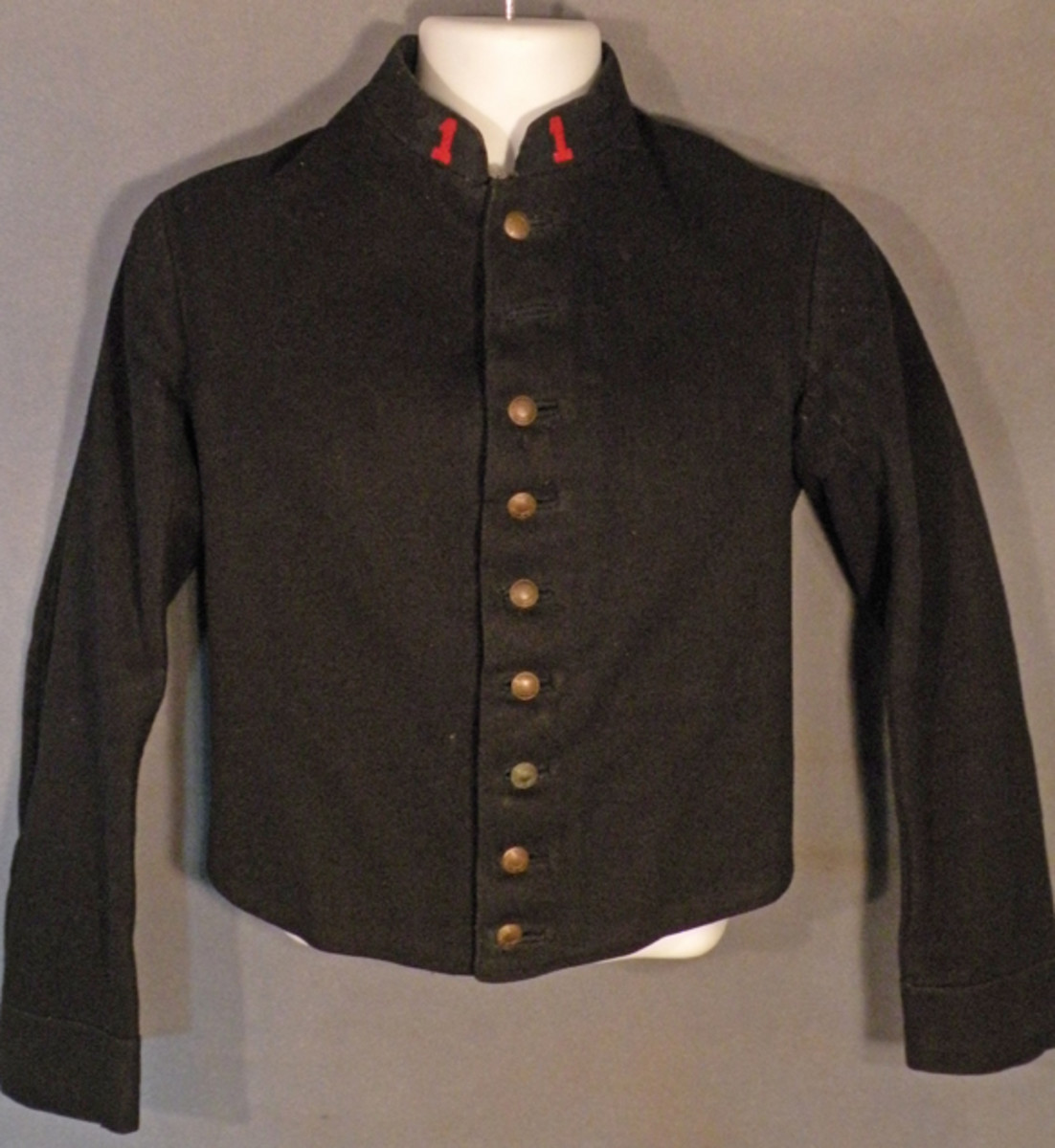 Model 1870 French enlisted tunic with numbered collar insignia for the 1st Marching Regiment, French Foreign Legion.