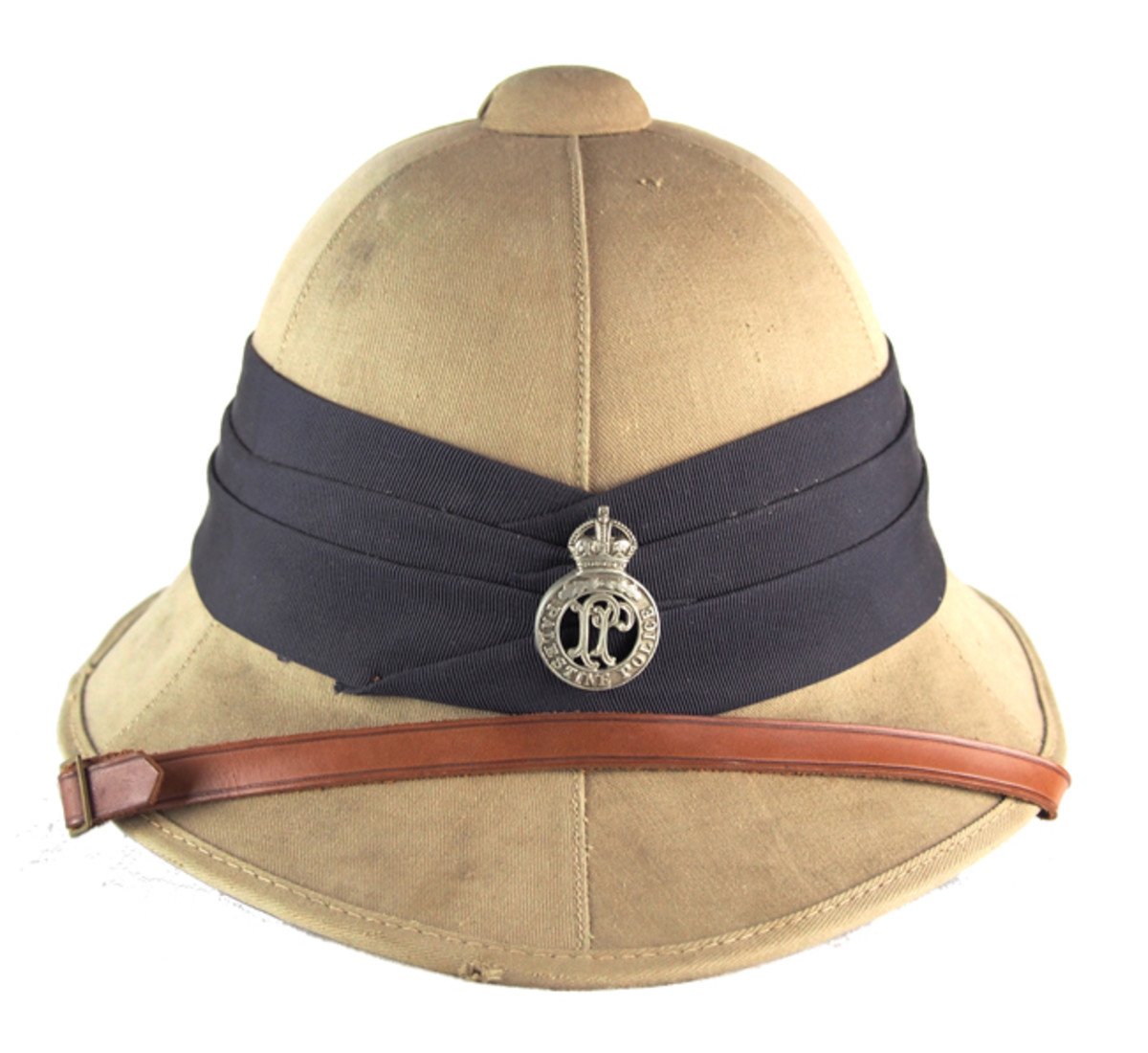 A 1941 dated Wolseley helmet with the black puggaree denoting territorial police forces along with a Palestine Police Force badge. This helmet is of the latter pattern Wolseley and is made of pressed felt – and ersatz material that was used in place of cork during World War II. (Author's Collection)