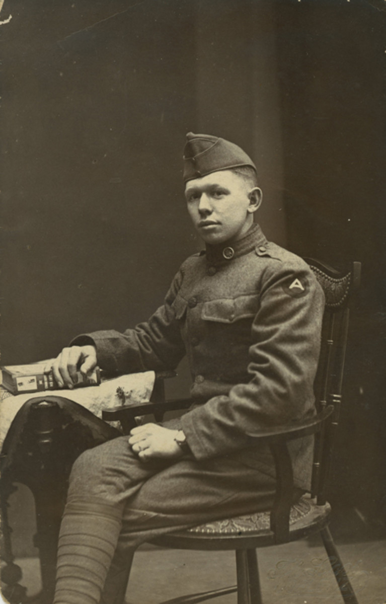 A nicely uniformed transportation corps soldier from the 310th Mechanical Repair Unit, Sergeant Samuel Fleming, poses for a portrait in Coblenz. Fleming, a former University of Cincinnati student from Adams, Ohio, has chosen an interesting German-language book to pose with: Die Eroberung Der Luft (The Conquest of the Air). What is the message he is trying to give us? (Photo courtesy JAG Collection)