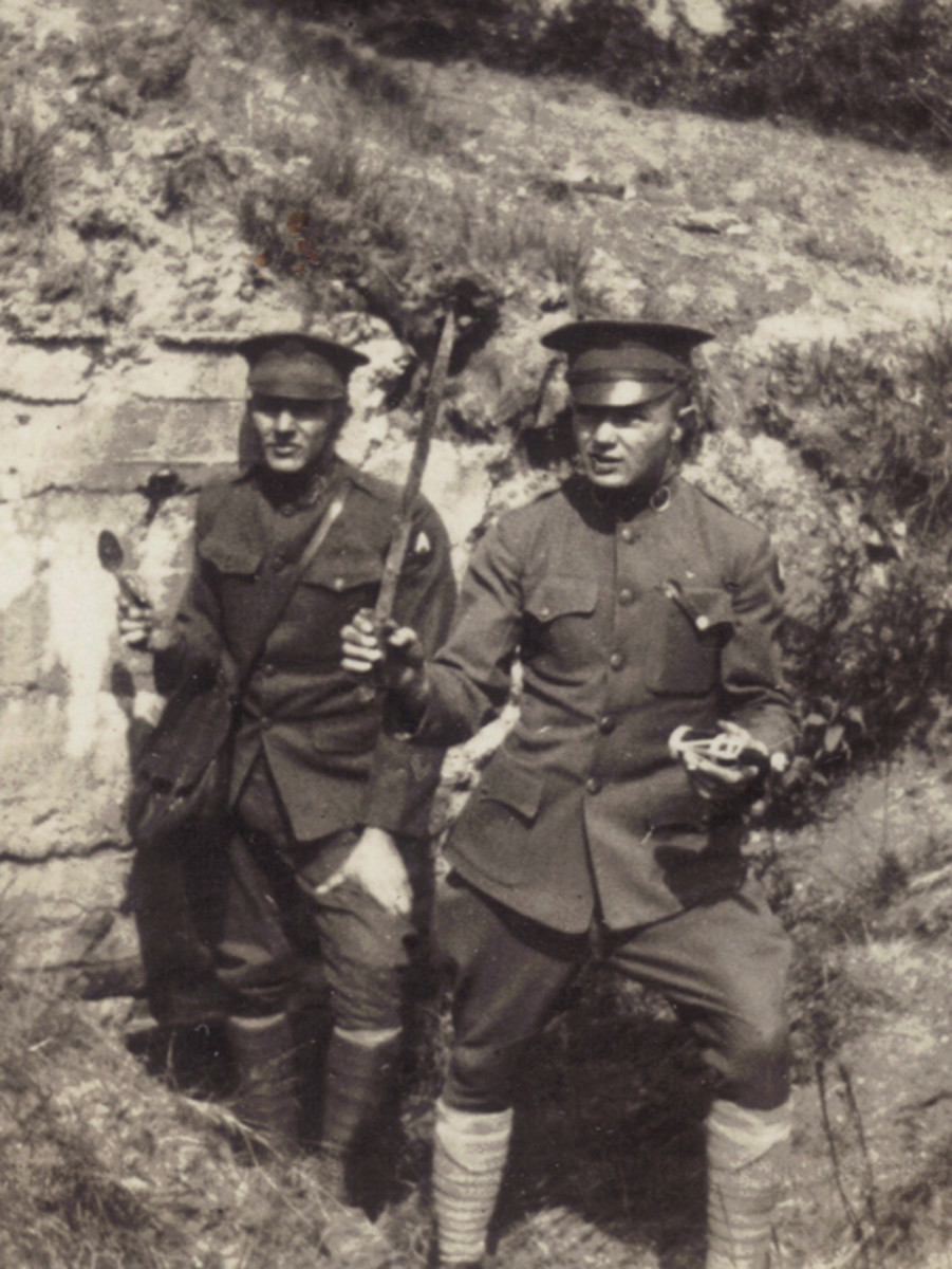 Among the many off-duty pursuits of the US soldiers assigned to the Occupation of Germany in the early 1920s were trips to visit the battlefields of the Great War. Here two well-uniformed soldiers emerge from an old bunker brandishing a bayonet, a bottle, and a spoon. With most of the battlefields in France still covered with live ammunition of all sizes, such exploration was probably not the smartest way to spend their leisure time.