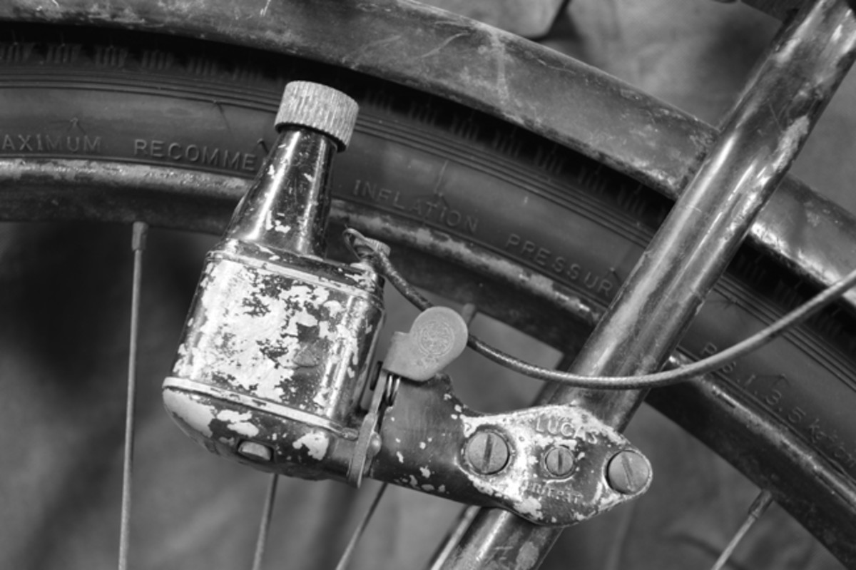 """A small generator that is turned from the rear wheel by a friction-driven dynamo powers the headlight. It is marked with the """"King of the Road"""" logo."""
