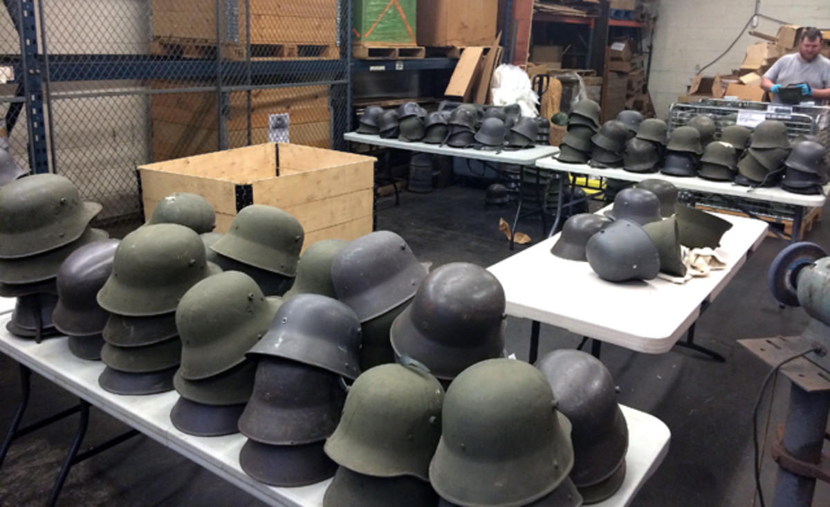 Part of the fun for the IMA crew, has been sorting the recent discovery by type: M16s, Austrian-made M17s, M18s, and even some WWII-era M35s and M42s. Most have been heavily painted with Finnish gray or dark green paint over the original German paint.