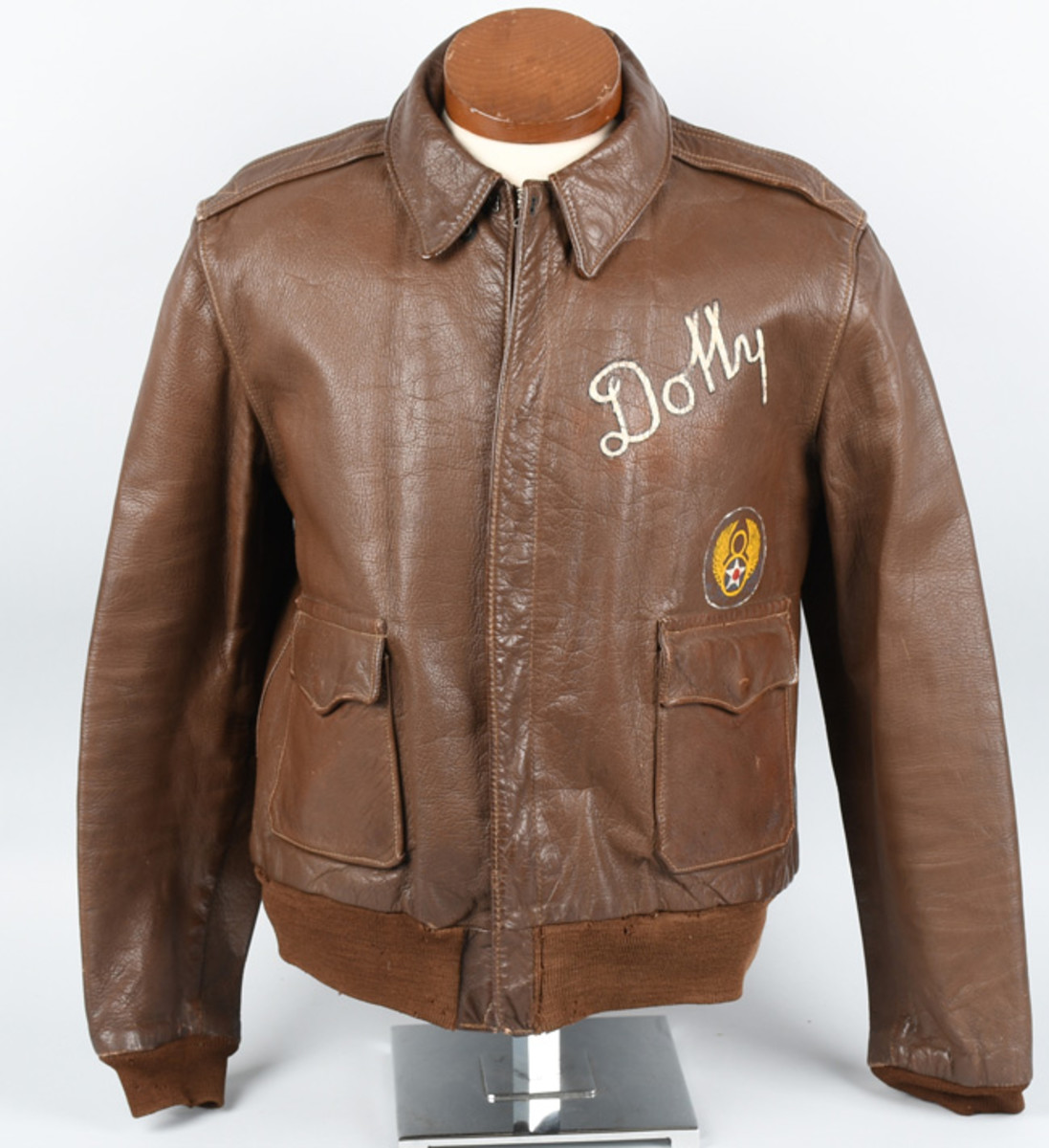 Original WWII A2 flight jacket that belonged to U.S. B-17 pilot Roland Leroy Hess of 8th Air Force, 379th Bomb Group. Small bomb bursts on jacket denote locations of bombing missions. Pilot's name inside; wife's name on front. Estimate: $4,000-$5,000. Image - Milestone Auctions
