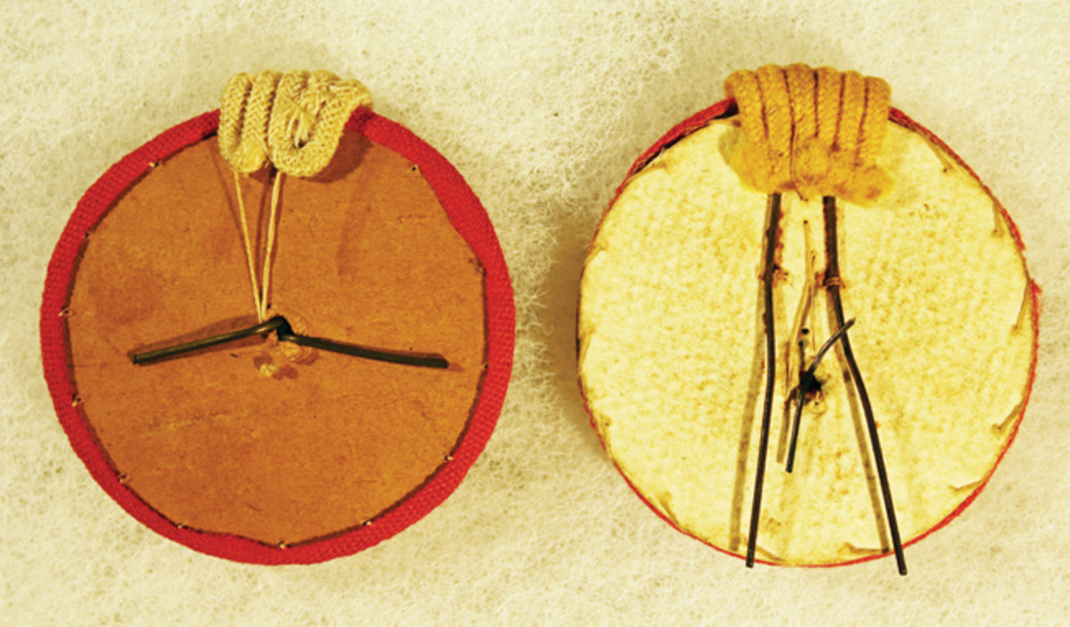 Reverse of cockades from Cuba (left) and Puerto Rico. Note the two prong wire clip on the Puerto Rican example.