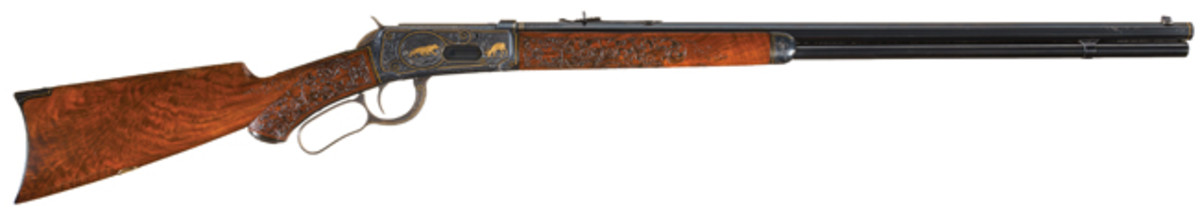 LOT1014 - Magnificent John Ulrich Masterpiece Factory Engraved, Signed, Gold Inlaid, and Elaborately Ornamented Winchester Model 1894 Lever Action Rifle From the Legendary Mac McCroskie Collection