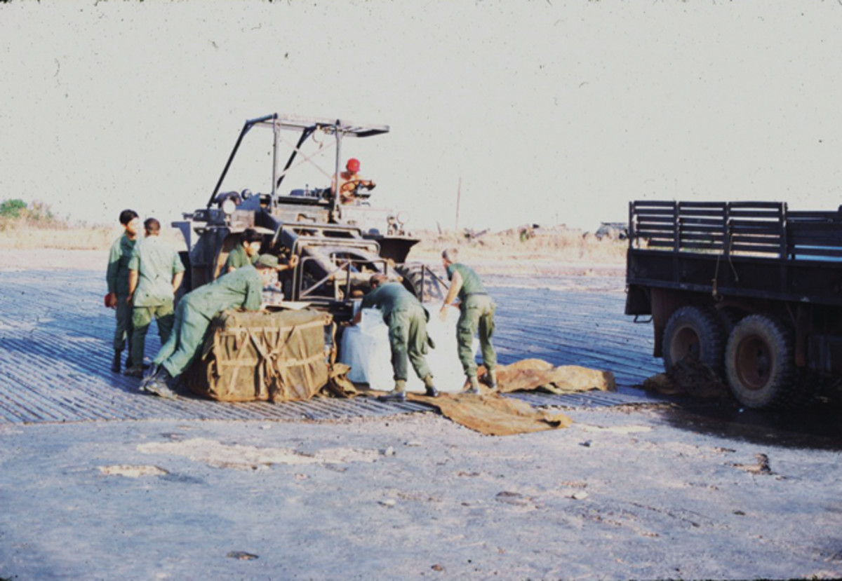 Loading ice at Bien Hoa, Republic of Vietnam, March 1972. They were making a sling load to Chinook the ice to the field. The ice came in 300-lbs blocks.
