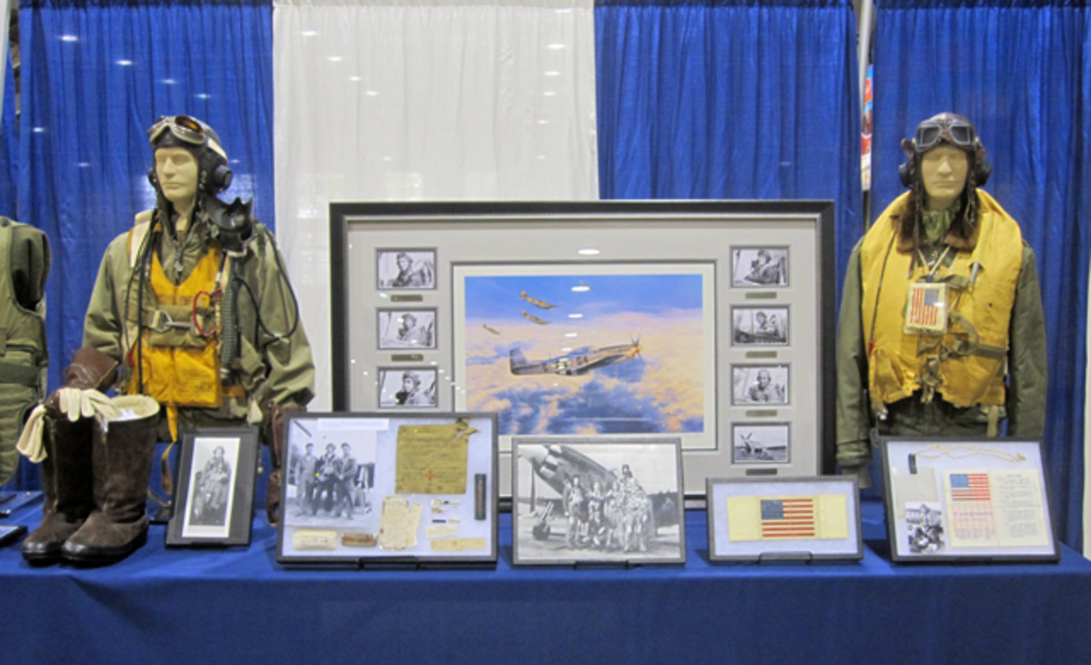 A large WWII aviation display produced some nice groupings of flight suits, service jackets, associated paper work and art.