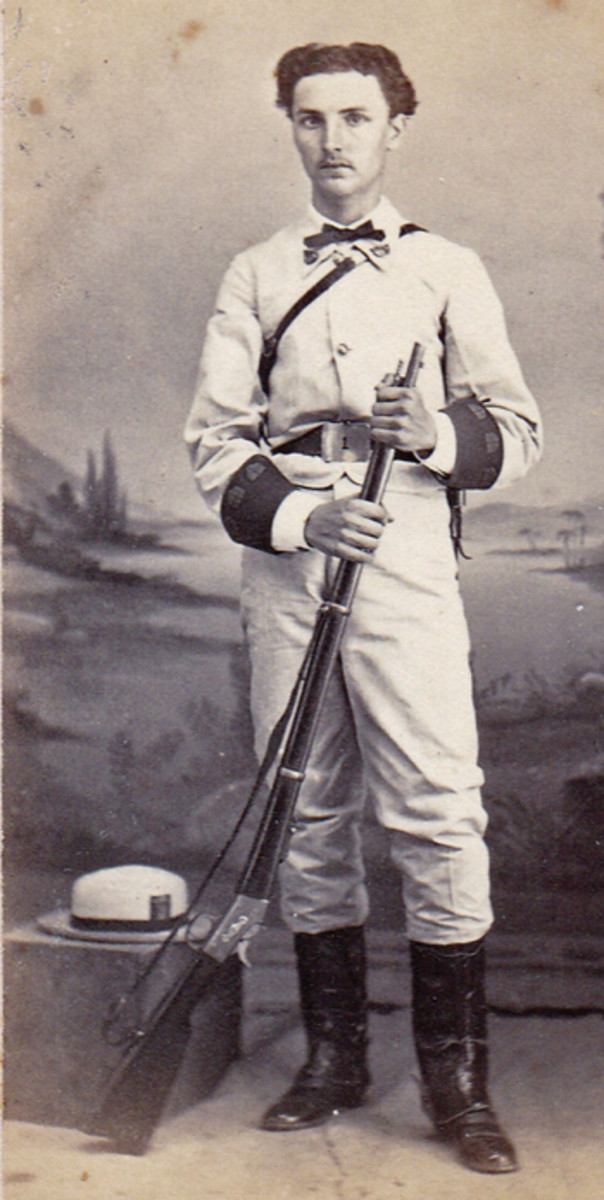 A volunteer infantryman in Cuba, ca.1870. Note the pre-1871 red square cockade on his straw hat.