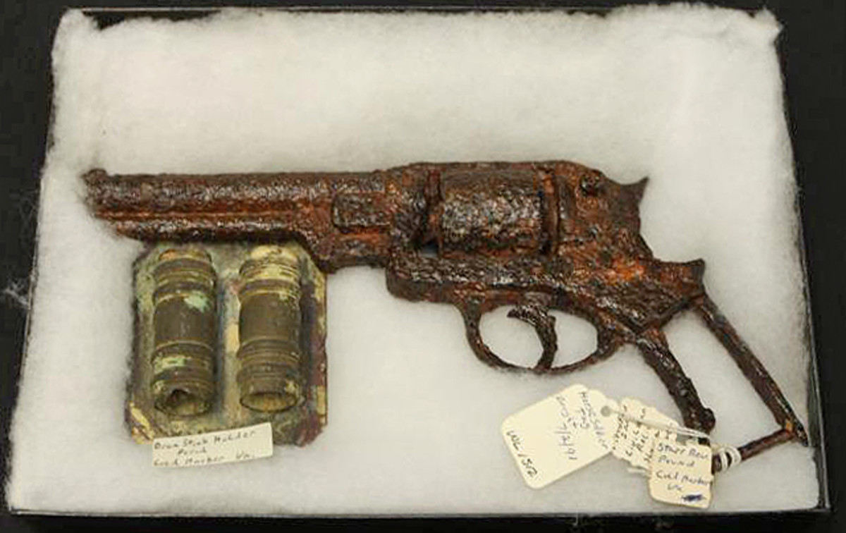 Civil War Starr revolver and drum stick holder sold for $403.