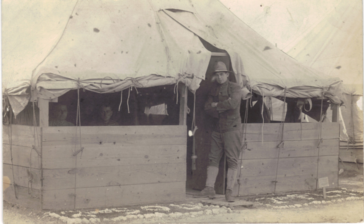 At the time, military planners felt it made sense to house Guard units in tents rather than wooden barracks. All Guard units already had tents as part of their standard equipment. The Guardsmen pictured above have written their company and platoon information with small pebbles outside the door of their squad tent.