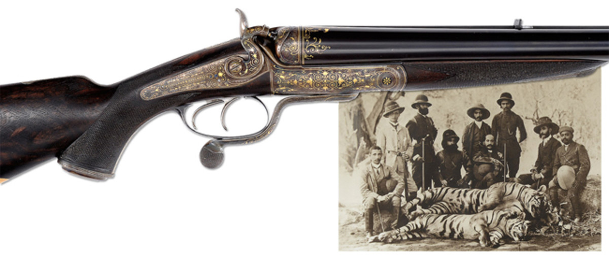Lot 2355 Gold inlaid ten bore Holland & Holland hammer rifle made for the Nizam of Hyderabad with original case and spectacular new display case with ivory accessories. (Prestigious Single Owner Collection of English Stopping Rifles. Extraordinary Session, March 15th)