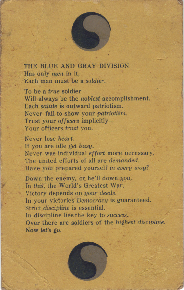 "Certainly a nice collectible from the training camp period, this card was distributed to members of the 29th Division before they deployed to France. It already includes the ""Blue and Gray"" symbol and perhaps the very first use of the 29th's motto, ""Let's Go."""