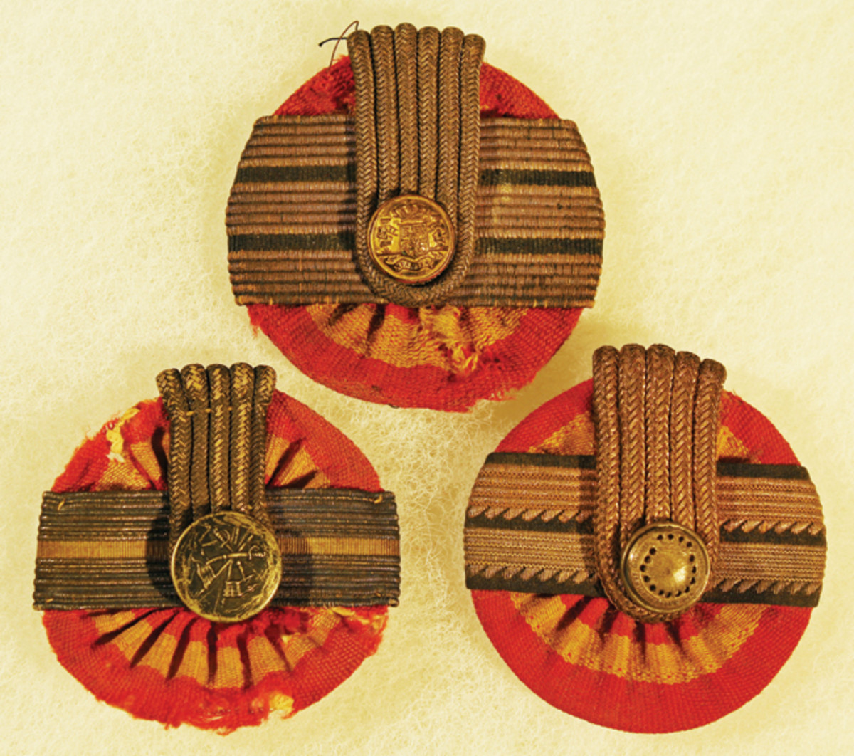 Officer's Cockades: Top: Infantry Captain. Bottom: Cavalry 1st Lieutenant, Military Administration 2nd Class Official. Note the serrated edge on this non-combatant branch braid, a feature also found on medical officer's rank braid.